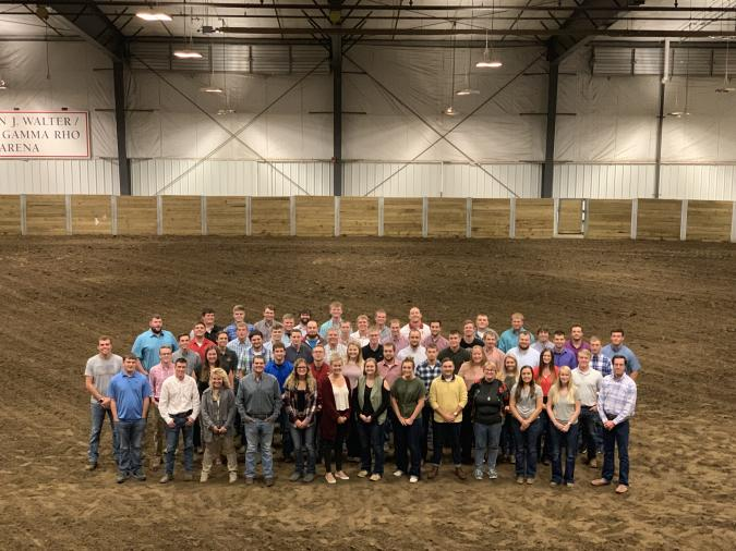 About 60 people members of the 2019 Ag 450 farm class pose for a photo in a really big shed